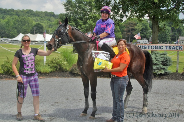 Race winner Karen Isbell on Truth In Action in the winner's circle with RUS New York Marketing Director and Draper Team Member, CJ Millar