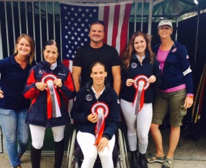 U.S Para- Dressage riders with their coaches at the Mulhouse, CPEDI3* Left to Right Rider Deborah Stanitski with ribbon and trainer Lauren Palmer Rebecca Hart (sitting) with Todd Flettrich; and Annie Peavy with Heather Blitz. Photo By: Rebecca Reno.